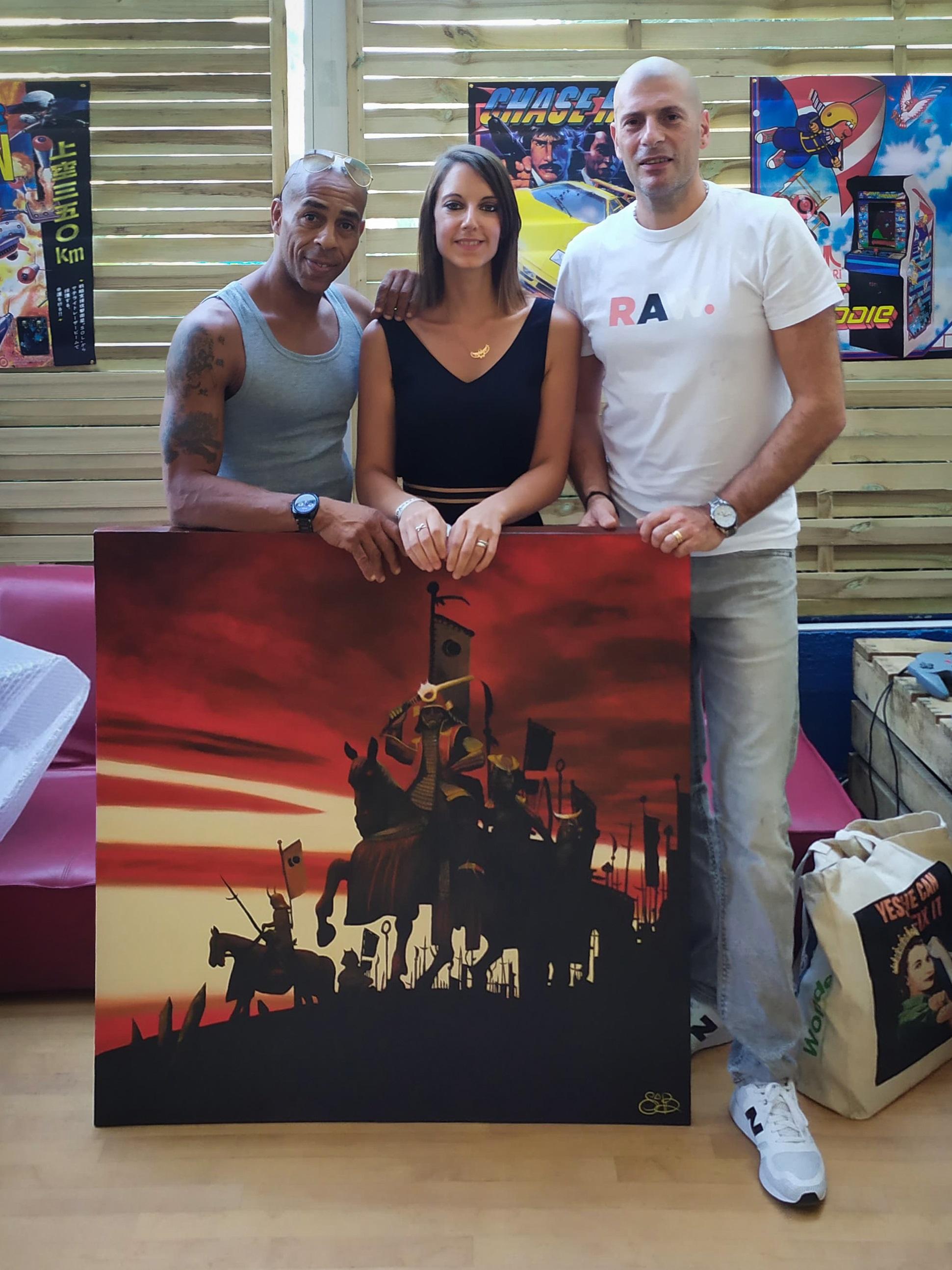 Sabrina Beretta offre sa peinture reproduisant l'album l'École du micro argent au groupe IAM